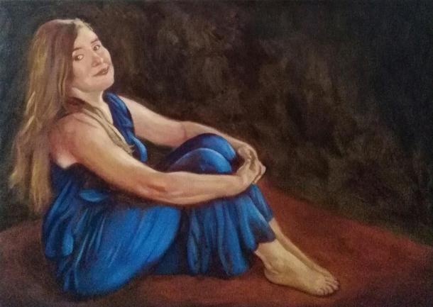 Vrouw in het blauw, zittend
